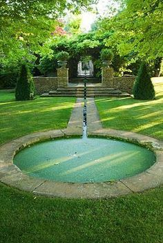 Stacked Stone, Limestone Pond Surround, and Conical Shaped Evergreens in this Formal Parisian Garden. Garden Pool, Water Garden, Formal Gardens, Outdoor Gardens, Garden Fountains, Outdoor Fountains, Water Fountains, Water Features In The Garden, Parks