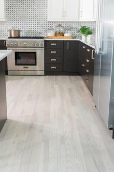 Used Throughout The House Bleached And Faded Hardwood Floors Bring A Lightness To Rooms Including Kitchen