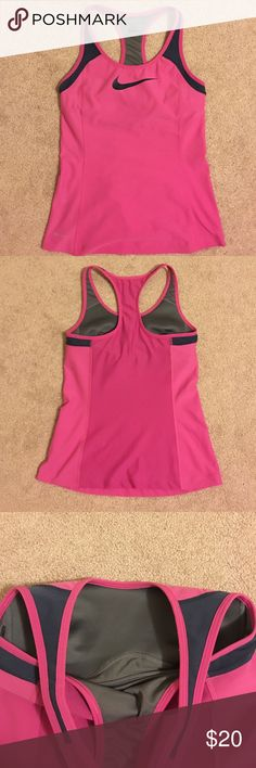 Nike Dri-fit running tank Only wore once Nike tank. Selling because it doesn't fit me anymore. Nike Tops