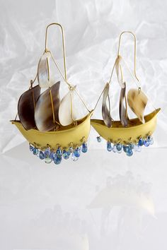 """Hand made clipper ships in 18K with horn sails and diamond water drops; one-of-a-kind piece; 2 1/2"""" from top of horn to bottom of the lowest sapphire x 1 3/4"""" from end to end $9K"""