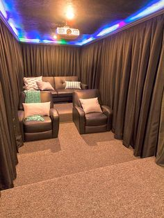 A DIY Home Theater room- hang curtains around your seats for increased darkness during the show