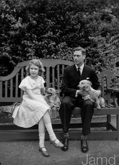 George VI and his daughter, the future Elizabeth II with their corgis.