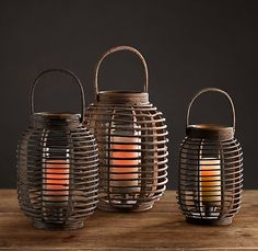 RH's Balinese Lantern:Rich brown strands of natural rattan are woven into an airy, open framework, creating a dramatic play of light and shadow. A glass hurricane, raised on a platform inside the lantern, shelters the candle from breezes. Bali Style Home, Deck Lighting, Lighting Ideas, Bali Decor, Candle Lanterns, Led Lantern, Candles, Eclectic Living Room, Spa Design