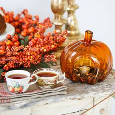 Featuring a beautiful array of berries in various shades of orange complemented by faux green leaves, this Balsam Hill exclusive wreath proclaims a season of cheer and abundance with its vibrant colors. 📸 by thirstyfortea Autumn Tea, Autumn Garden, Glass Pumpkins, Fall Pumpkins, Balsam Hill, Thanksgiving Traditions, Berry Wreath, Harvest Season, Glass Candle Holders