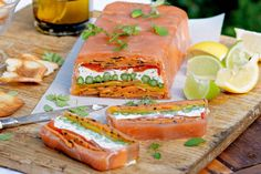 Chargrilled vegetable terrine with smoked salmon - Get your party started with this salmon wrapped terrine with dill-speckled goats cheese.