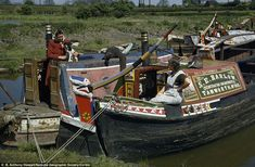 Slower pace of life: Wives of bargemen rest and talk on decks of barges tied up in a canal in Warwickshire