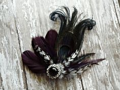 Deep Plum Purple and Black Peacock Hair Clip by stylesbym.  Its time for prom!!! I do custom orders or you can pick from styles I have on my etsy site.