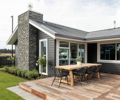 Building their first home and a show home all in one was a huge challenge, but this clever Oamaru couple knocked it out of the park. Weatherboard Exterior, Home Building Companies, House Cladding, Exterior Paint Colors For House, Exterior Design, Black Exterior, Exterior Doors, Outdoor Living Areas, The Ranch