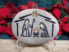 A sand engraved, unique, natural stone Nativity Set to begin or add to your collection. Celebrate every Christmas, Joyously with this Holy Family ensemble. 5 inches tall 6 inches wide 2 inches deep. Pretty Purple stone. This listing is for ~1~ natural stone, engraved NATIVITY. It includes 1 glacier stone with -----Baby Jesus -----Joseph -----Mary This river stone hales from the Snake River Valley in the Rocky Mountains of Idaho. It is just the right size to place on a shelf, mantle…