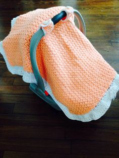 Handmade peaches and cream colored baby crocheted carseat cover canopy