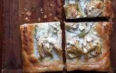 This recipe gives you yet another excuse to keep a package of puff pastry in the freezer. If you prefer, swap out the marinated artichoke hearts for drained canned or thawed frozen artichoke hearts.