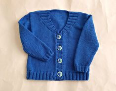 Handknit blue baby cardigan - pretty flower buttons, 1 year wool sweater with V neck, size 12 months baby clothes, knitted girl sweater Cardigan Design, Baby Girl Sweaters, Knitted Baby Cardigan, Baby Month By Month, Wool Sweaters, Baby Knitting, 1 Year, Baby Blue, Knitwear