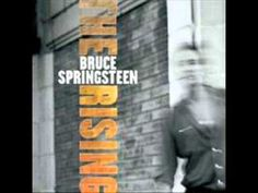 Bruce Springsteen - My City Of Ruins     Lyrics:   There's a blood red circle   on the cold dark ground   and the rain is falling down   The church doors blown open   I can hear the organ's song   But the congregation's gone     My city of ruins   My city of ruins     Now the sweet veils of mercy   drift through the evening trees   Young men on the corner   lik...