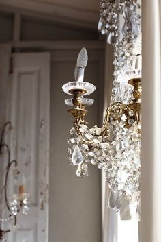 Small chandelier by the window