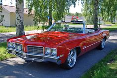 my first car 1975 olds delta 88 convertible in red
