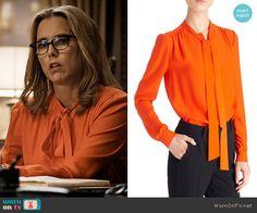 Elizabeth's orange tie-neck blouse on Madam Secretary.  Outfit Details: https://wornontv.net/67464/ #MadamSecretary