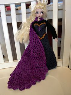 """I loved Elsa's coronation dress from the Disney movie """"Frozen"""", so I decided to crochet one for her - and I posted the pattern so you, too, can make a coronation dress for a lucky Barbie! Even if you don't want to make the dress, you could use the cape for other purposes too."""