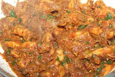 Semi-dry spicy, tangy chicken in a Goan based masala