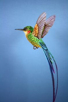 Handmade paper and wood long tailed hummingbird sculpture, available here: www.etsy.com/shop/ZackMclaughlin