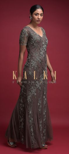 Buy Online from the link below. We ship worldwide (Free Shipping over US$100)  Click Anywhere to Tag Hippo Grey Fish Cut Gown In Net With Embellished Floral Pattern Online - Kalki Fashion Hippo grey fish cut gown in net.Embellished with cut dana, beads and sequins work in floral pattern.