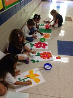 Making flowers in the style of Eric Carle--so cute!