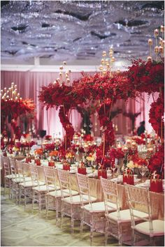 Pin by angelita hill divine weddings special events on wedding spiraling red floral wedding table decor five questions with lily chew of wishing tree junglespirit Gallery