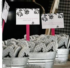 Great idea to display your buckets of flip flops at the entrance to the beach ceremony.