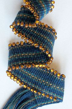 The article teaches beaded edge using beads on the warp threads on a rigid-heddle loom.