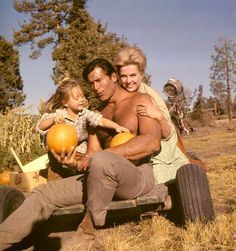 """Clint enjoys picking pumpkins with actress Martha Hyer and little actress Victoria Paige Meyerink between filming the 1966 western movie """"The Night Of The Grizzly."""" Little Victoria Paige steals the show and the heart of the viewer in some of the scenes. Hollywood Stars, Classic Hollywood, Hollywood Actor, Vintage Hollywood, Night Of The Grizzly, Clint Walker Actor, Cheyenne Bodie, American Indian Girl, Tv Westerns"""