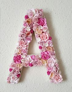 Personalise your room or perhaps the nursery with a beautiful floral initial, made from a wide selection of faux flowers, in light pinks. The letter is covered with off white burlap. Available in 8, 10, 12, 14 and 16 inches. I also make larger than this, please contact me with your requirements. Please note the flower types and layout may vary but only slightly. They can be wall hung. I can make to any colour scheme, or any size, just convo me with your requirements. I can colour match a...