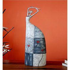 DIVA EN POLIREZINA -  Estilizada figura de decoración terminada en tonos grises que armonizan con cualquier ambiente.  https://enviaregalo.com/producto/a-domicilio/diva-en-poliresina-2#.UYCR-YKCxFM