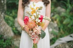 @Katy Payne hawaiian tropical bouquet.  so pretty!  and she has your dress on!  it looks cute with a belt