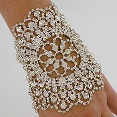 Swarovski crystal,silver plated Jeweled Nouveau Bouquet Cuff. Lovely.