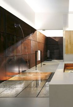 Conceptual bathroom with corten steel wall..... if only the room is like a sauna, hate a cold bathroom after a shower