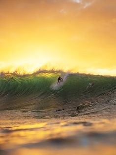 gabs at pipe with the sunset in his back ph: corey wilson