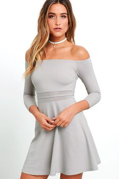 We think you will agree that the Yes to the Mesh Grey Skater Dress will be worth a night out (or two)! Warm grey knit begins at an elastic off-the-shoulder neckline above fitted three-quarter sleeves and a darted bodice. Bands of sheer mesh accent the waist while a skater skirt creates a fantastic finish below. Hidden side zipper.