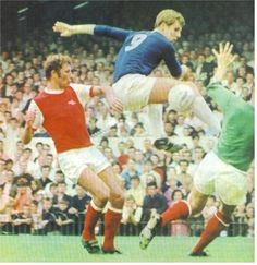 11th September 1968. Everton centre forward Joe Royle gets between Arsenal's Bob Wilson and Terry Neill at Highbury.