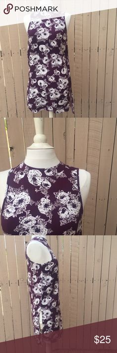 "Side Slit Purple Floral Sleeveless Tunic Purple Floral Tunic with slits in the side. Could wear a slip underneath, or wear it as a top. From an Australian brand so the size is ""8"" but would fit a small or medium Tops Tunics"