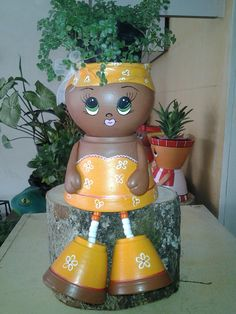 Clay pot doll