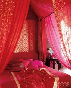 Red Rooms: Decorating With the Color Red - Fabulous red fabric with gold embroidery and pink sheers create a beautiful Moroccan style bed