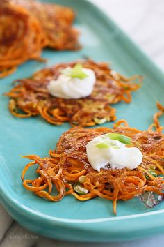 Spiralized sweet potatoes , This light recipe with 5 ingredients Sweet Potato Latkes is a healthier take on the traditional deep fried potato pancakes. Such a tasty sweet potato . Sweet Potato Latkes, Sweet Potato Pancakes, Sweet Potato Recipes, Sweet Potato Spiralizer Recipes, Sweet Potato Noodles, Paleo Pancakes, Savory Pancakes, Zoodle Recipes, Vegetarian Recipes