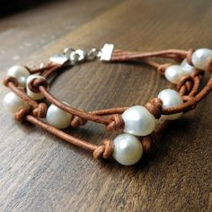 """$50 Ask any southern girl, and she'll tell you... pearls go with everything! Our Cowlicks and Kudzu Dogwood triple strand freshwater pearl and leather bracelet goes perfectly with anything from a cute dress to jeans and a t-shirt. Each pearl is hand knotted on the leather in our facility in Griffin, GA. 7"""" with 2"""" extender - See more at: http://www.morgan-company.com/product.cfm?p=3850&c=47&page=cowlicks-and-kudzu-dogwood-pearl-and-leather-bracelet#sthash.8igSKvt3.dpuf"""