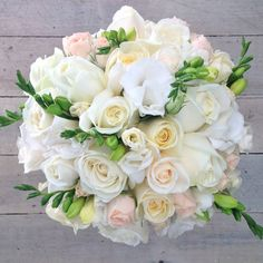 Classic ivory coloured wedding bouquet with roses, lizianthus and spring time freesias. Flower Bouquet Wedding, Bridal Bouquets, Floral Wedding, Wedding Day, Spring Time, Flower Arrangements, Floral Design, Floral Wreath, Weddings