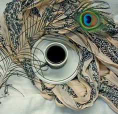 Coffee and a peacock,love it
