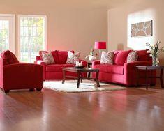 Sofas in Rot mit beige Wänden