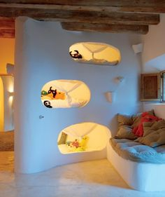 """Kids beds in mini-caves. Cave House by Alexandre de Betak in Majorca, Spain. Check out these natural home design ideas, courtesy of this stone house by Alexandre de Betak. Hidden away in a small village in Majorca, """"Cave House"""" is Modern Bunk Beds, Cool Bunk Beds, Kids Bunk Beds, Unique Bunk Beds, Cave House, House Art, Deco Kids, Earthship, Kid Spaces"""