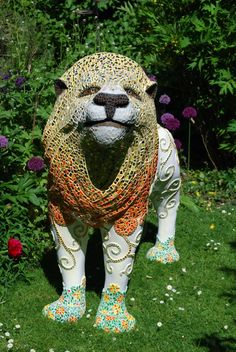 Lion in my garden. A labour of love. He took me a month to complete.
