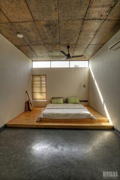Idyllic zen bedroom, oxide flooring, platform bed, floor bed, sunlight, sunshine, early morning, concrete ceiling, Studio Nirvana