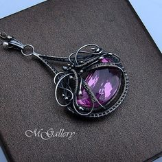 Pink topaz pendant wire wrapped silver by GaleriaM on Etsy
