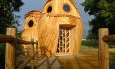 A cluster of three hollow wooden owls peer out from the end of a dock in Bordeaux, France, connected from within to form a two-story cabin. The Watchers was designed and built by Zebra3, a local contemporary art production company. The design was inspired by the small owls that nest on the ground in